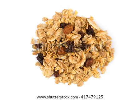 Top close view of a dry mix of fruit and almon nuts cereal on white - stock photo