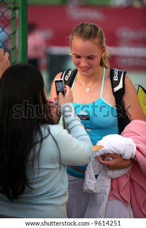 Top Danish tennis star, 17-year-old Caroline Wozniacki gives autographs after upsetting eighth seed Marion Bartoli in the Qatar Open, February 19, 2008