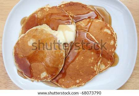 Top Down View of Pancakes With Butter and Syrup - stock photo