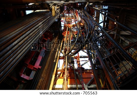 Top drive and derrick on an offshore oil rig - stock photo