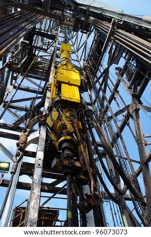 Top Drive System (TDS) Spinning for Oil Drilling Rig - Oilfield Industry - stock photo