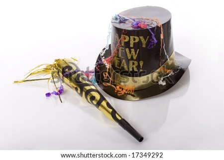 Top hat that says happy new year and other party favors isolated against white background - stock photo