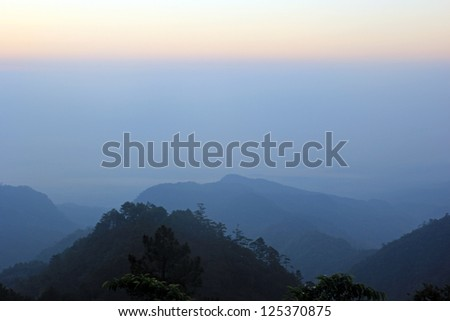top hills and sunrise. Composition of the nature at Chiangmai Thailand