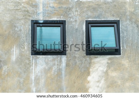 Top hung windows on the concrete wall - stock photo