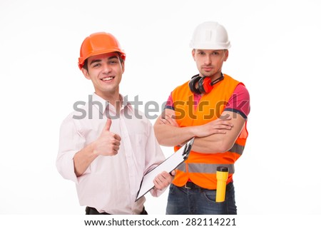 Top manager from International Building Corporation showing OK sign. Worker in helmet and orange jacket looking so serious. - stock photo