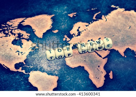 TOP NEWS on grunge world map - stock photo