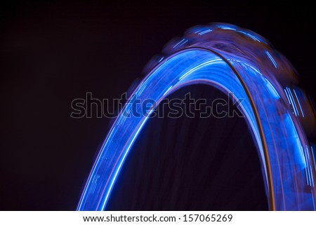 Top of a blue Ferris Wheel - stock photo