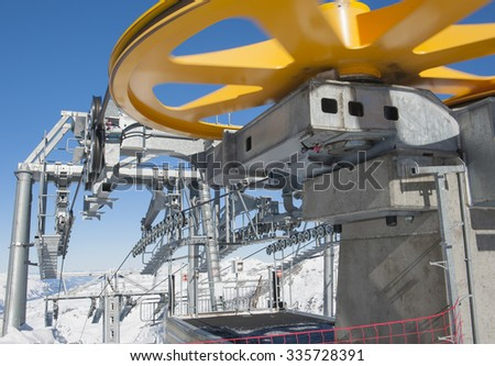Top of a large alpine cable car lift on mountain in ski resort