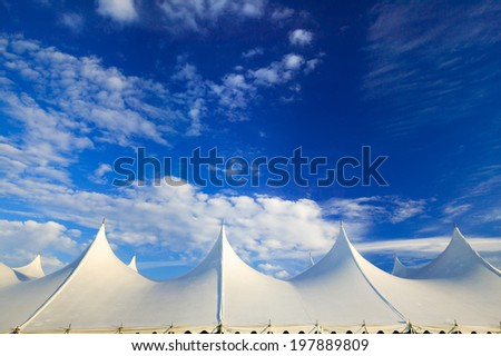 Top of a large event tent against a blue sky in Stowe, Vermont, USA - stock photo