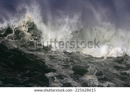 Top of a powerful wave approaching the north coast of Portugal - stock photo