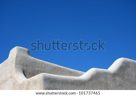 Top of an adobe style building in Santa Fe - stock photo