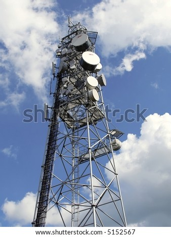 top of antenna mast under sky with clouds - stock photo