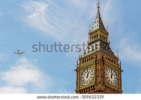 Top of Big Ben and airplane in sky in London, UK. Image with selective focus - stock photo