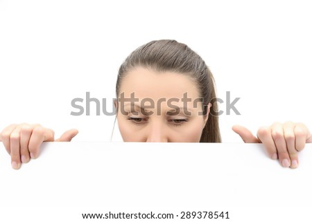 Top of female face behind white banner, isolated on white - stock photo