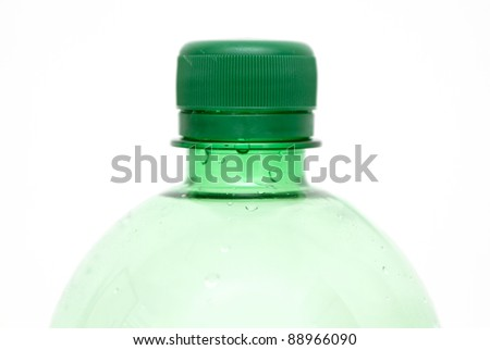 Top of green plastic bottle of mineral water - stock photo