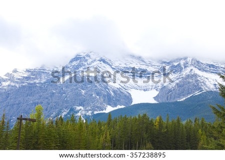 Top of High mountains, covered by snow and clouds