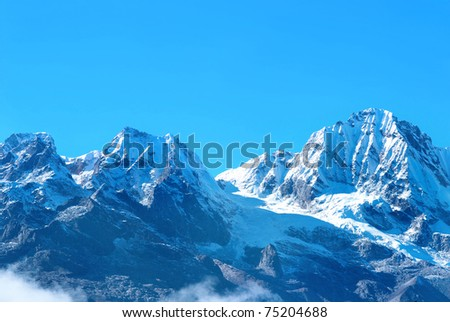 Top of High mountains, covered by snow. Kangchenjunga, India. - stock photo