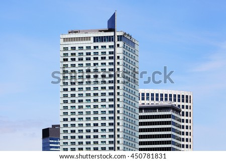 Top of high-rise business office building on blue sky. InterContinental hotel, Warsaw, Poland.