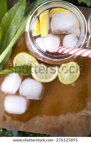 top of lemon juice mug with ice and lemon on wooden board space - stock photo