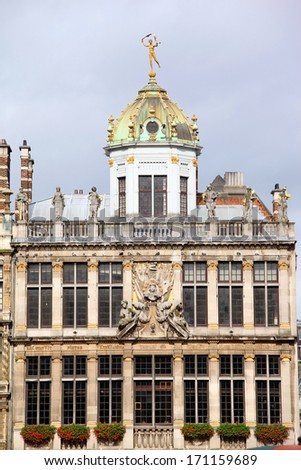 Top of medieval building on Grand Place in Brussels in sunny day with flowers  - stock photo