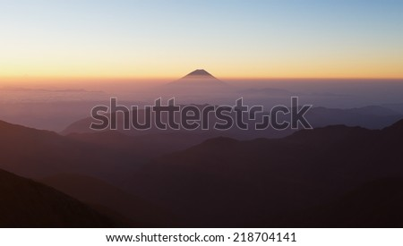 Top of Mountain Fuji with fog and cloud in early summer morning