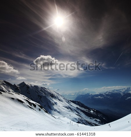 top of mountains in blue sky - stock photo