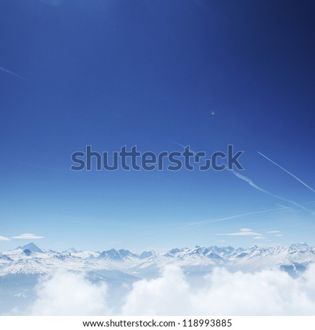 top of mountains sun in blue sky - stock photo