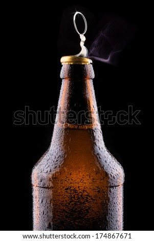 Top of open wet beer bottle isolated on black - stock photo