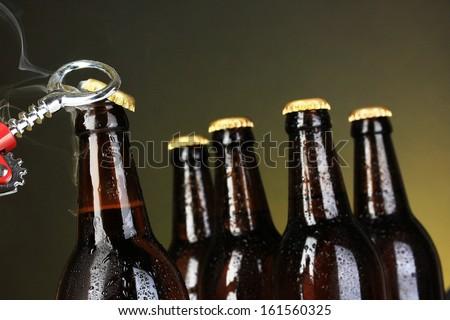 Top of open wet beer bottle on dark background - stock photo