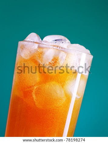 top of soda glass with ice over blue background - stock photo