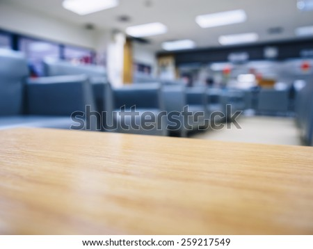 Top of table with blurred sofa waiting room office space - stock photo