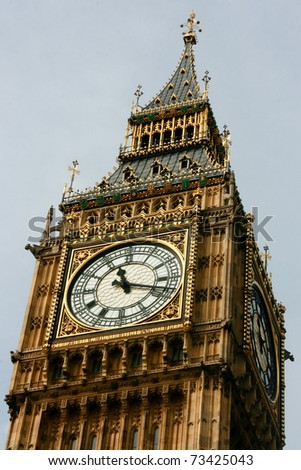 Top of the Big Ben clock tower in London on a cloudy day - stock photo