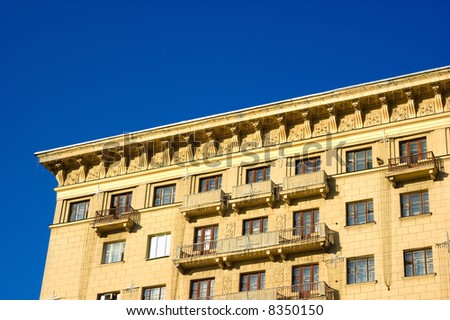 Top of the building. Roofs, balcony, windows and sky - stock photo