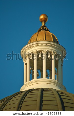 top of the California Capitol building in Sacramento illuminated by the afternoon sun - stock photo