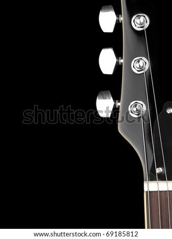 top of the guitar neck over black background, for entertainment or concert themes - stock photo