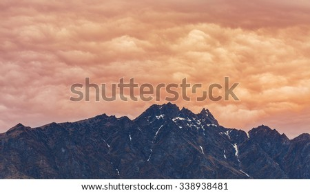 top of the mountain with dramatic cloud at the background in Queenstown, New Zealand
