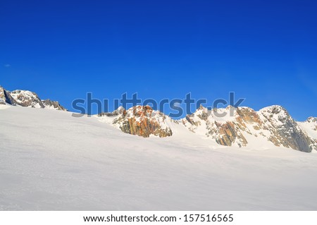 Top of the mountain with nice ice pattern - stock photo