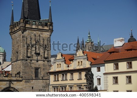 Top of the Prague castle as a part of the famous scenic Hradcany, above the red roofs  taken from the famous Charles Bridge