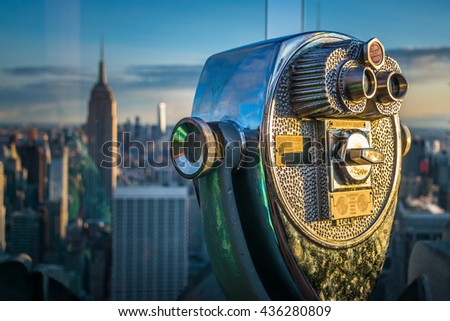 Top of the Rock binoculars with Empire State Building in the background - stock photo