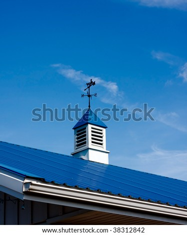 Top of the roof with cupola - stock photo