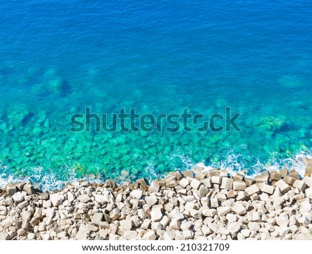 top of view limpid water on gravel beach isole tremiti italy - stock photo