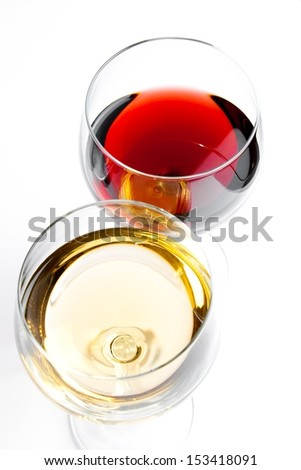 top of view of red and white wine glasses on white background - stock photo