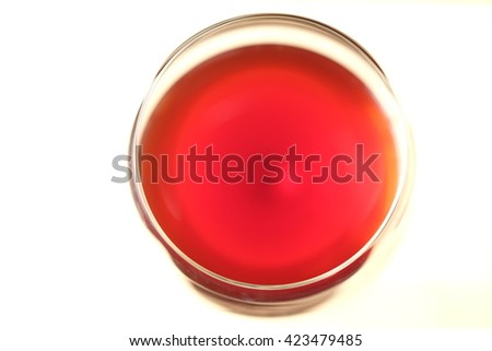 top of view of red wine in the glass isolated on wooden background with space for text