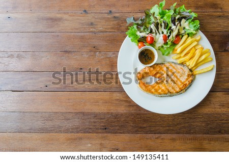 Top of view salmon steak on wood table - stock photo