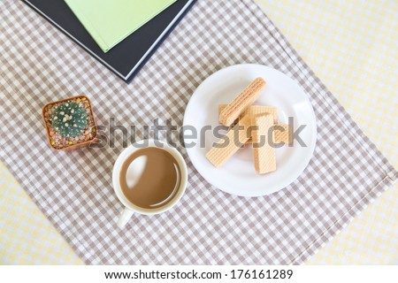 Top of view wafer cookies with a cup of coffee. - stock photo