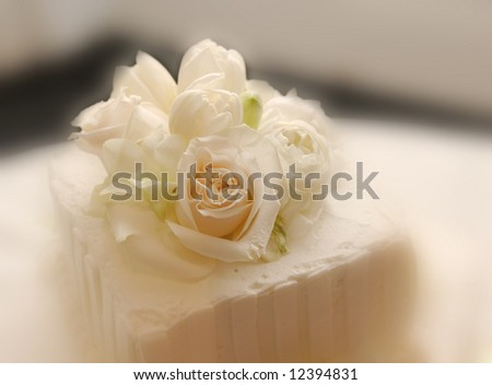 top of wedding cake for dessert, with flowers - stock photo