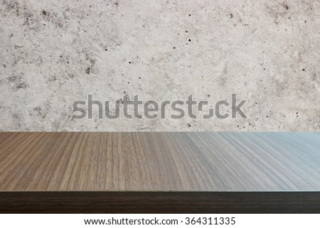 Top of wood table on concrete wall background. you can be used for display your products