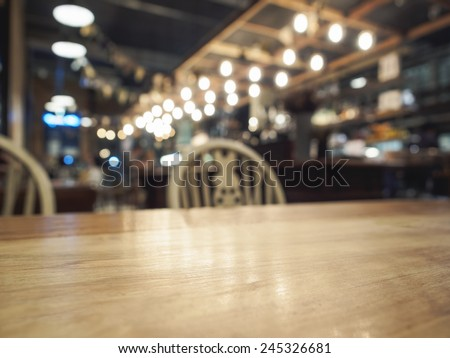Top of Wood Table with Bar Restaurant blurred background - stock photo