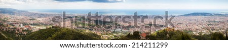 Top panoramic view of Barcelona from high point in cloudy day - stock photo
