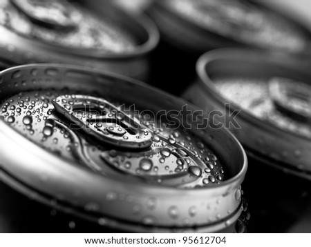 Top part of beer cans, close up view - stock photo